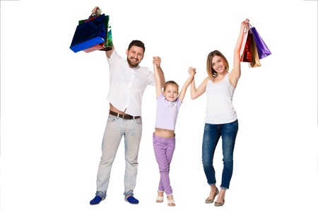 family mart: Happy family with shopping bags standing at studio, isolated on white background