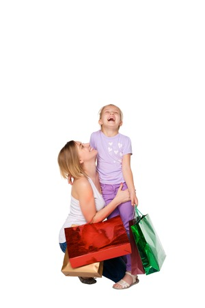 family mart: Happy  mother and daughter with shopping bags standing at studio, isolated on white background.