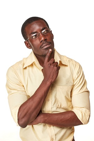 Young  black african man, thinking and looking up, isolated on white background