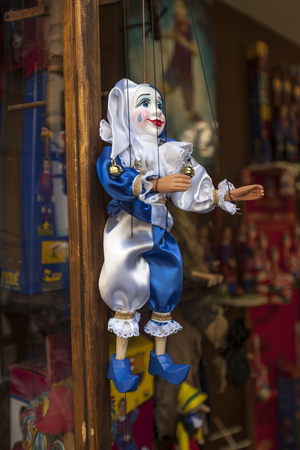 Prague, Czech Republic - 8 May, 2013: Prague souvenirs, traditional puppets made from wood in the gift shop. Stock Photo