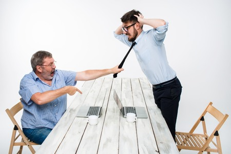 expressing negativity: Business conflict. The two men expressing negativity while one man grabbing the necktie of her opponent on white background