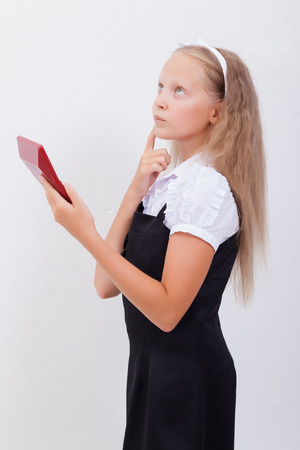 guile: Portrait of teen girl with calculator over white background