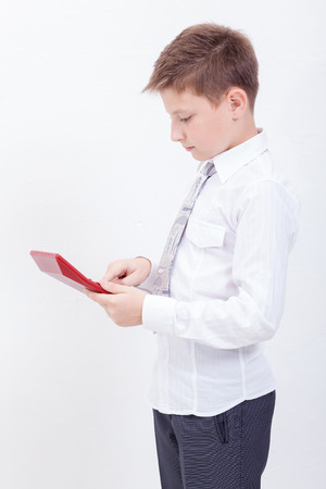 guile: Portrait of teen boy with calculator over white background