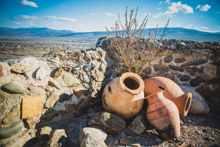 structural engineers: The ancient antique city Uplistsikhe in Georgia. amphora jars in the foreground
