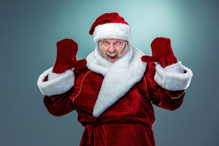 flashy: flashy Santa Claus in glasses with a gray beard on a blue background