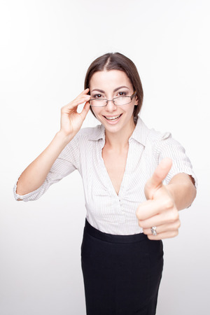 wonderment: The picture of a beautiful happy business woman with glasses on white background Stock Photo