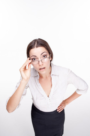 wonderment: The picture of a beautiful puzzled business woman with glasses on white background