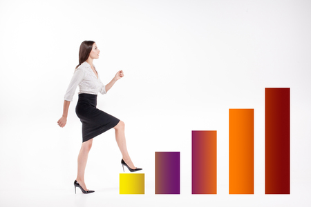 promotion girl: Young businesswoman walking up on the stairs of chart