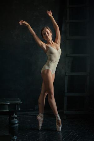 ballerina: The beautiful ballerina posing against a dark background Stock Photo