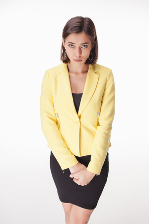 bescheiden: The picture of modest business woman on white background in a yellow jacket