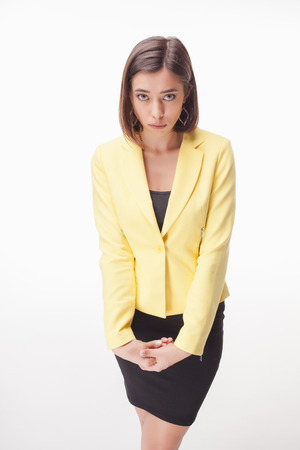modest: The picture of modest business woman on white background in a yellow jacket