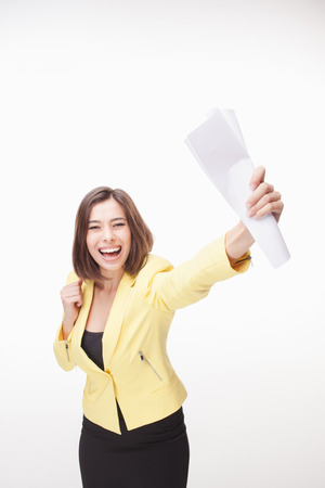 yellow jacket: successful  cheerful business woman in a yellow jacket on white background