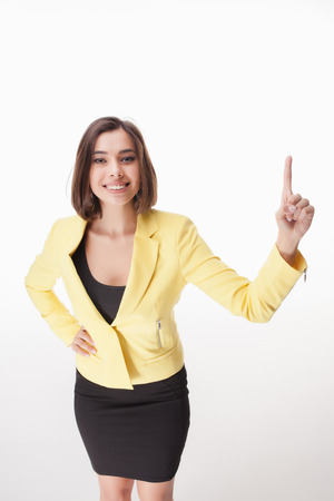 mujer trabajadora: The young business woman showing something on the white background