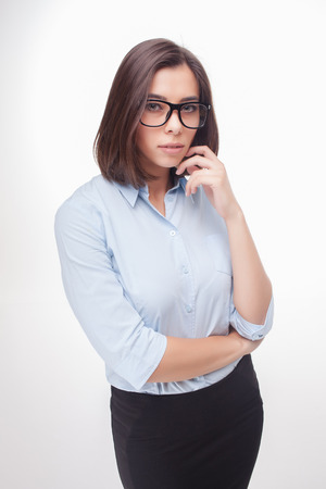 wonderment: The picture of a beautiful business woman with glasses on white background