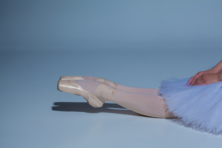 pointes: The legs of the ballerina in ballet  pointes on blue background Stock Photo