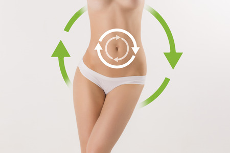 fat: Women belly with the drawing arrows on it on white. Fat lose, liposuction and cellulite removal concept. Stock Photo
