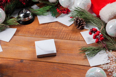 papeles oficina: The wooden table with Christmas decorations with copy space for text. Christmas mockup concept Foto de archivo
