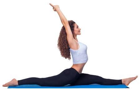 poses: Studio shot of a young fit woman doing yoga exercises isolated on white background