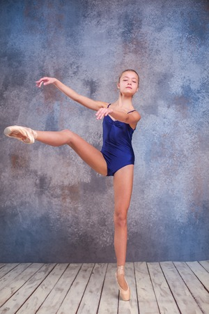 flexable: The  young ballerina  posing in studio on gray background Stock Photo