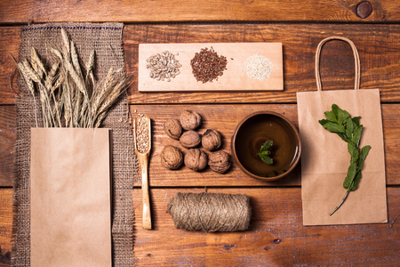 organic flax seed: The top view of collection of healthy superfood  with walnuts, spikelets,  wheat seeds  on wooden table Stock Photo