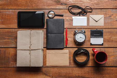 phone the clock: Mens accessories - phone, clock, , pens, tie butterfly, envelopes, partmane and pen  on the wooden table Stock Photo