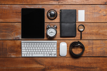 keyboard and mouse: Mens accessories - laptop, keyboard, mouse, partmane, belt, clock on the wooden table