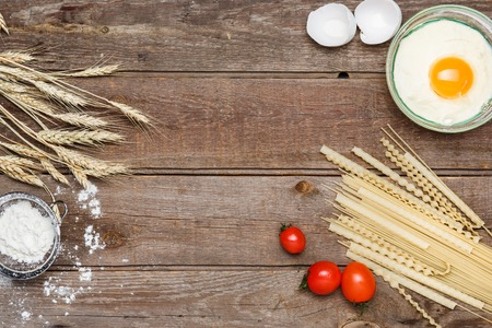 wheat grain: Healthy eating, noodle from the hard sorts of wheat, flour, grain, eggs on wooden table