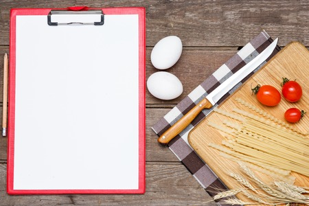 sorts: Healthy eating, noodle from the hard sorts of wheat, tomatoes, eggs on wooden table. The notebook for writing a prescription Stock Photo