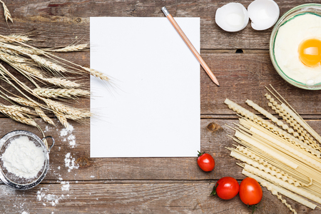sorts: Healthy eating, noodle from the hard sorts of wheat, tomatoes, eggs on wooden table. The paper for writing a prescription