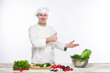 representing: The chef cooking fresh vegetable salad in his kitchen on white background and representing or promoting anything