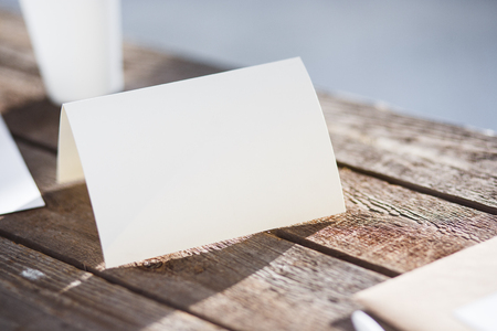 greeting card: Blank invitation greetings card to replace your design on gray wooden table Stock Photo