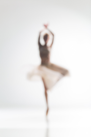 sport silhouette: Blurred silhouette of ballerina dancing on white background
