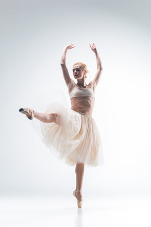 ballerina: The silhouette of ballerina dancing on white background