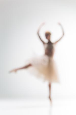 ballerina costume: Blurred silhouette of ballerina dancing on white background