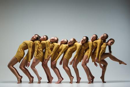 modern girl: The group of modern ballet dancers dancing on gray background