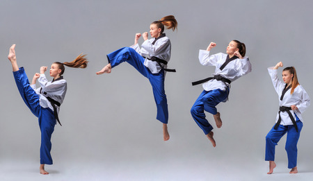 The collage of karate girl in white kimono and black belt training karate over gray background. Stock Photo
