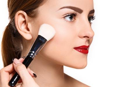 makeup eyes: Beautiful female eyes with make-up and brush on white