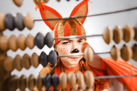 young add: The young woman in the image of red squirrel with abacus. The school and education concept