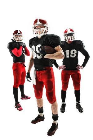 man power: The  three caucasian fitness men as american football players posing  full-length with a ball on white background Stock Photo