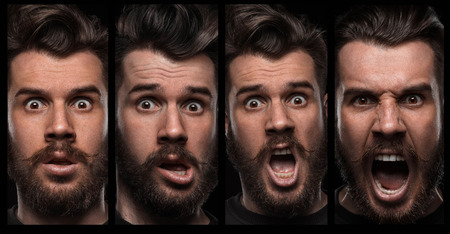 Set of young man's portraits with different emotions on black background