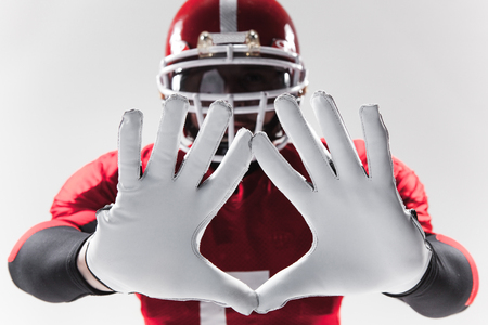 The hands of american football player on white background Stock Photo