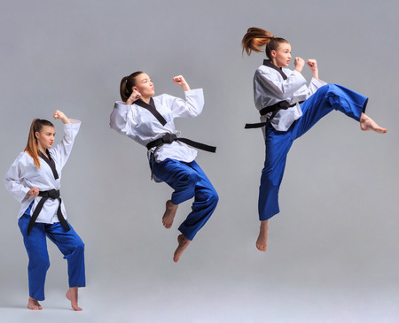 female kick: The collage of karate girl in white kimono and black belt training karate over gray background. Stock Photo