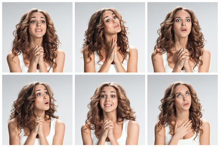 imploring: The set of portraites of young woman with softened facial expression  over gray background Stock Photo
