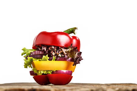 low cal: Healthy sandwich with fresh pepper, onion, salad lettuce on wooden background. Detox diet and healthy lifestyle. Stock Photo