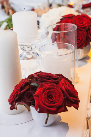celebratory: The red roses and candles on celebratory table