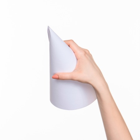 props: The white cone of the props in the female hands on white background with  right shadow Stock Photo