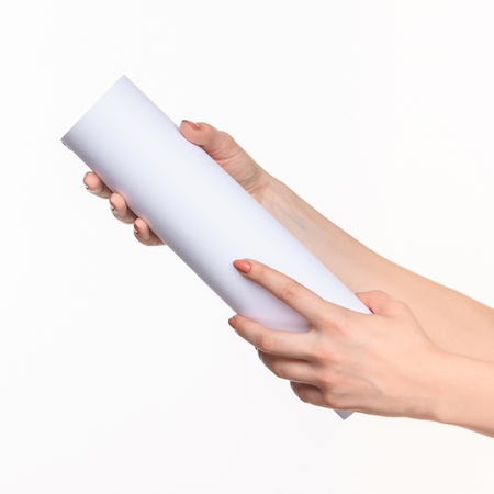 props: The white cylinder of the props in the female hands on white background with  right shadow