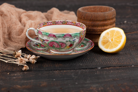 primroses: Tea with lemon and primroses on the wooden table