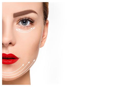 De jonge vrouwelijke gezicht met schone huid, anti-aging en draad lifting-concept Stockfoto