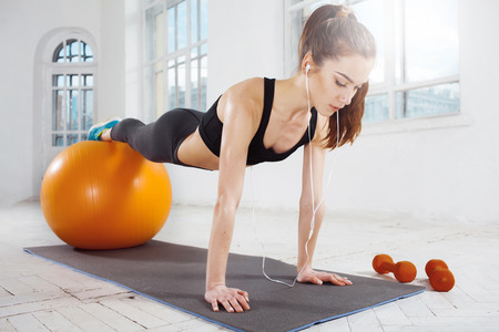 fitball: Beautiful young slim woman doing some gymnastics at the gym with fitball Stock Photo